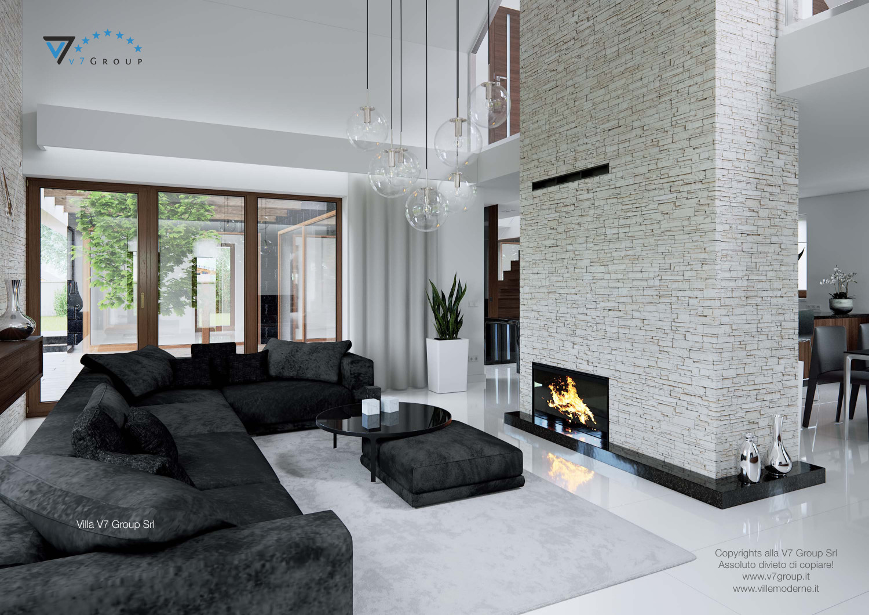 Immagine Villa V13 - il divano nero e il camino grande