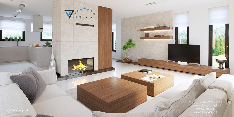 Immagine Villa V15 - il camino grande e la tv al centro del soggiorno