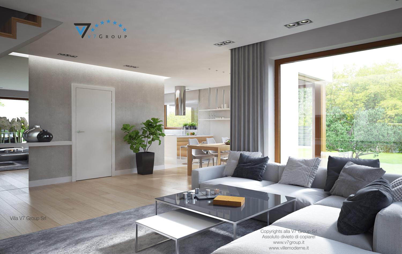 Immagine Villa V18 - il divano grigio e il tavolo nel soggiorno