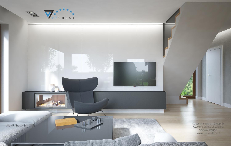 Immagine Villa V18 - la poltrona grigia e la tv nera nel soggiorno