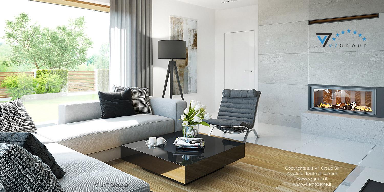 Immagine Villa V19 - il divano grigio e il camino grande