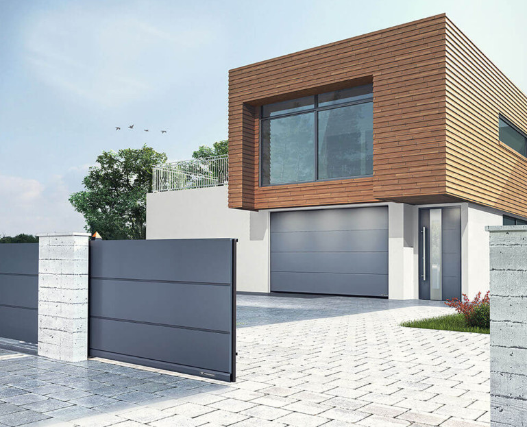 Immagine Porte garage - il canello, la porta garage e la casa